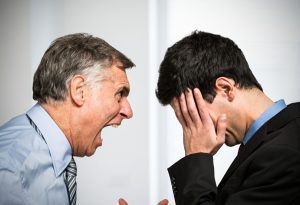 Mental health counselling for anger management - older man shouting at young man
