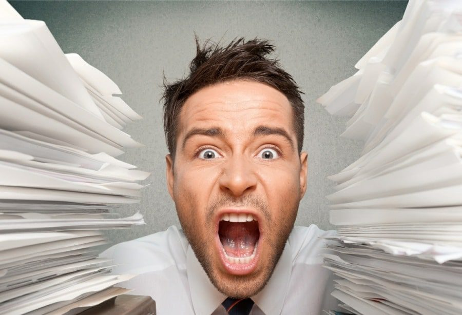 Practical Tools for Coping with Stress in Wolverhampton - man buried in paperwork