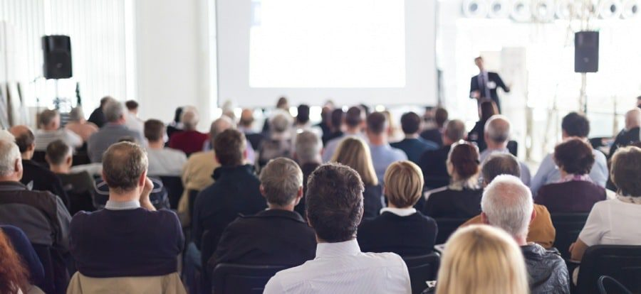 glossophobia fear of public speaking banner - business executive making a public presentation