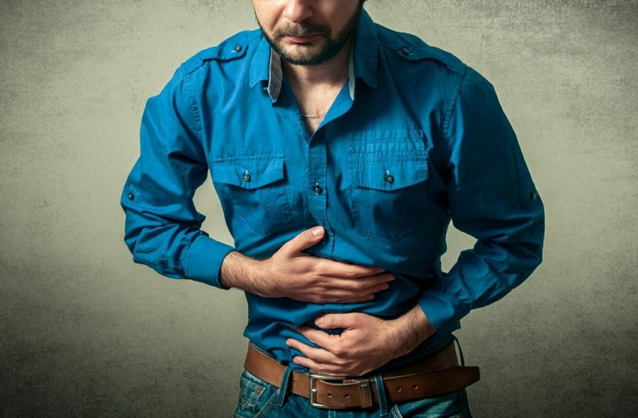 algophobia fear of pain - man with stomach cramps