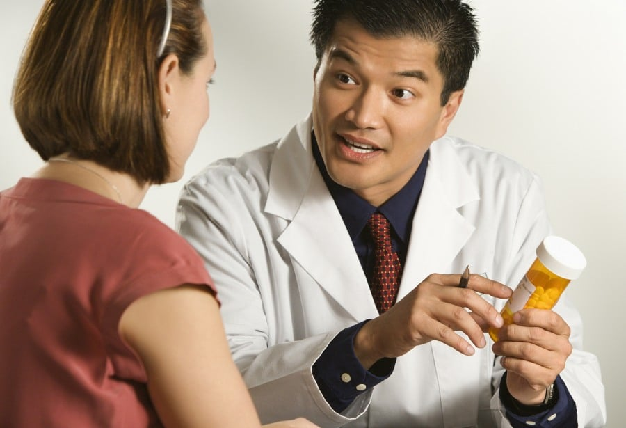 Pharmacophobia Fear of Medication - Doctor Prescribing Medication to Patient