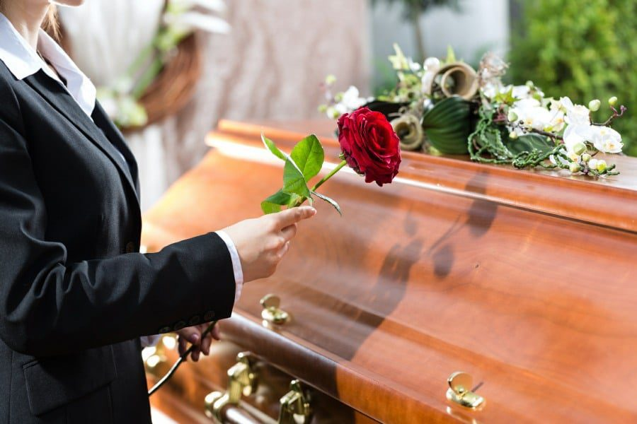 fear of dying - thanatophobia -woman at side of coffin