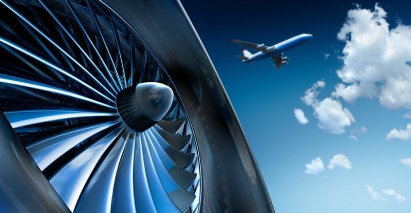 aviophobia is the fear of flying - close up shot of plane engine with plane in distance