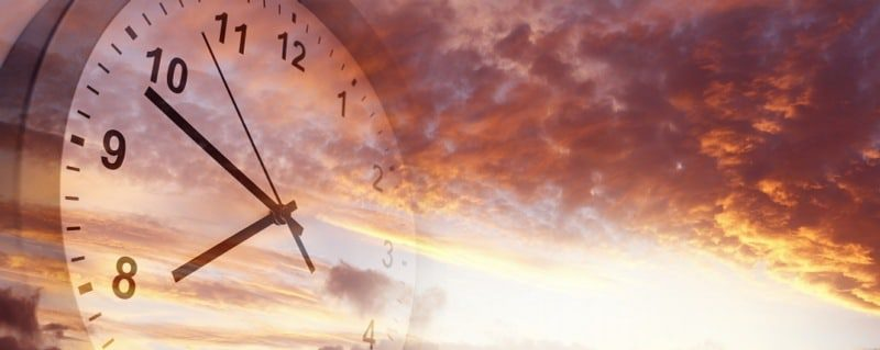 chronophobia is the fear of time or passing time - clock face superimposed on sky