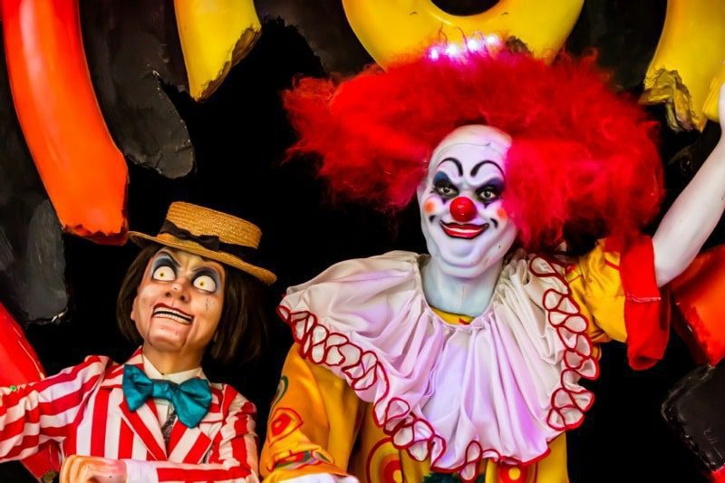 fear of clowns coulrophobia - brightly coloured clowns with sinister faces