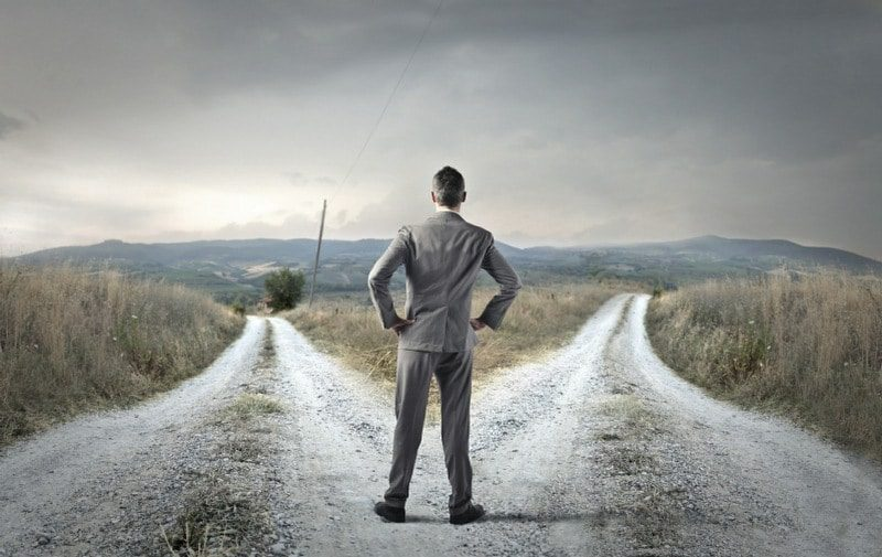 decidophobia is the fear of making decisions - man at a junction in the road