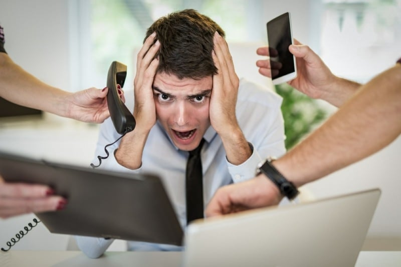 ergophobia is the fear of work - stressed man in the workplace