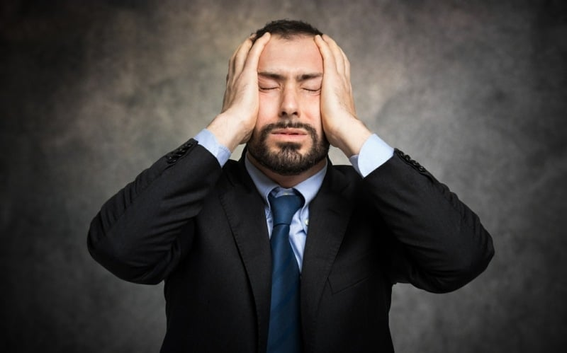 atelophobia counselling - man stressed about a mistake