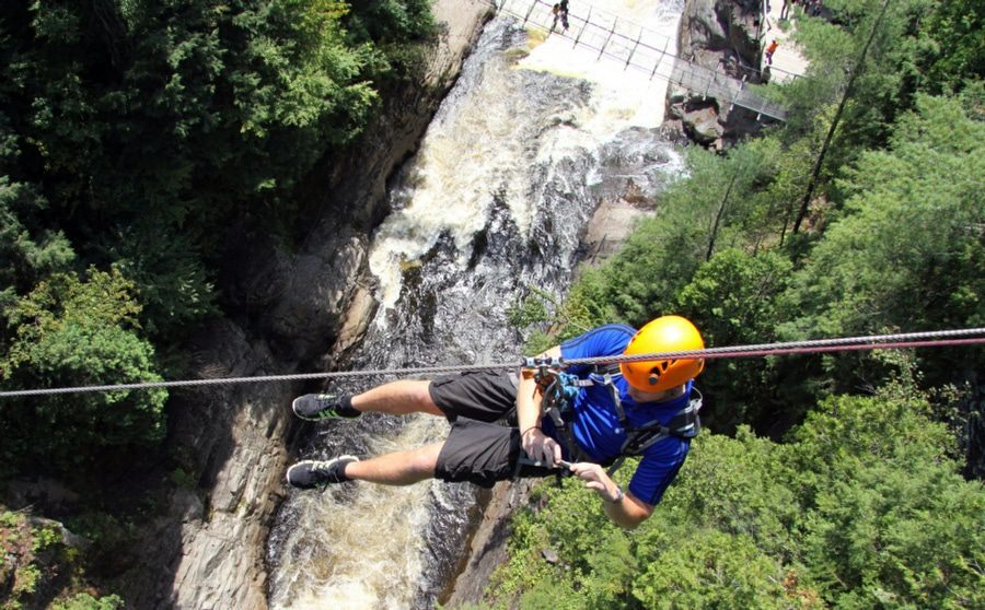 Fear of Heights Counselling Wolverhampton - Man hanging over ravine on rope