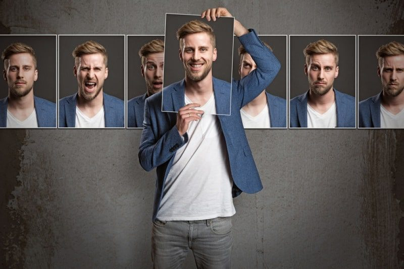 emotional reasoning thinking errors - man experiencing a range of different emotions simultaneously