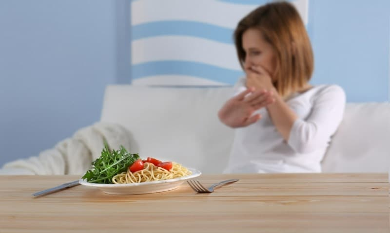 safety behaviours in emetophobia - woman avoiding food