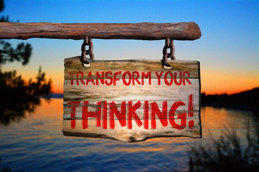 positive mindset course wolverhampton - transform your thinking sign above a lake