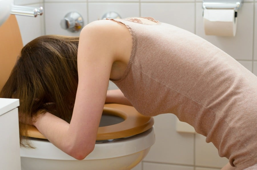 fear of being sick counselling wolverhampton - woman being sick in toilet
