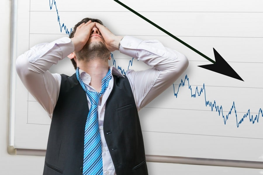 Fear of Failure counselling - man next to disastrous sales results chart