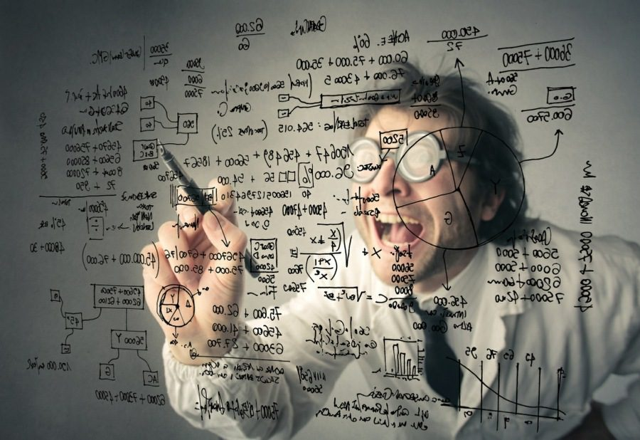 overthinking counselling wolverhampton - mad scientist writing detailed formula on glass