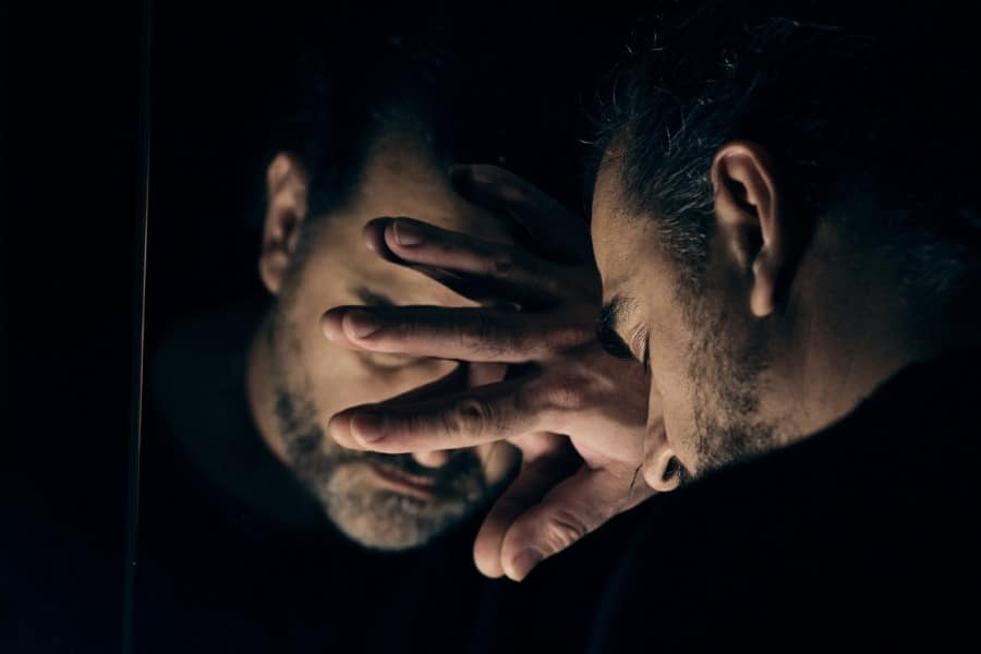 paranoia counselling in wolverhampton - man hiding from his mirror image