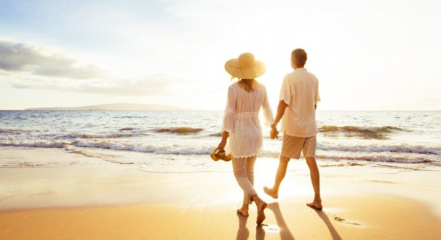 coping with anxiety in wolverhampton - chilled-out couple walking along a beautiful beach