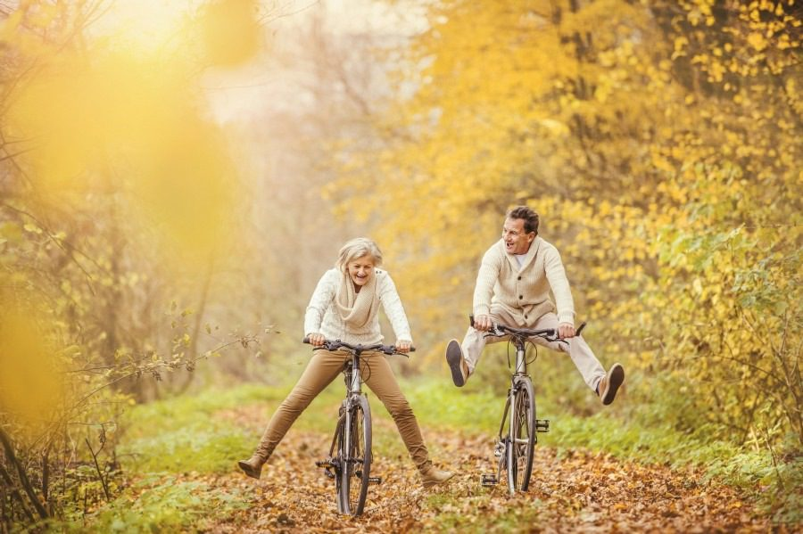 coping with life in wolverhampton - mature couple enjoying riding bicycles outside