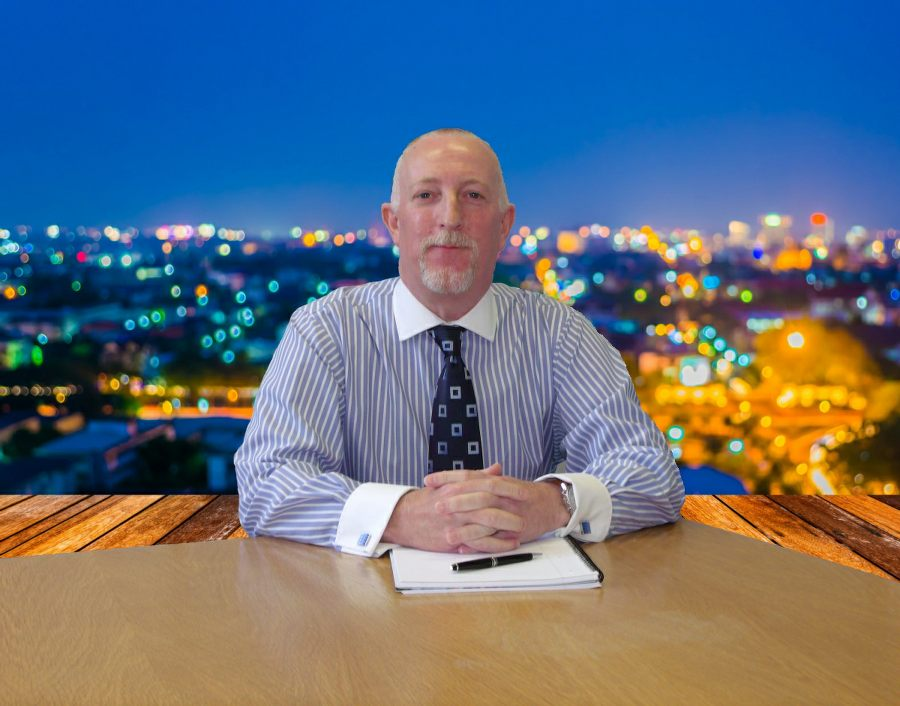Consultant Psychologist Paul Lee with city lights background
