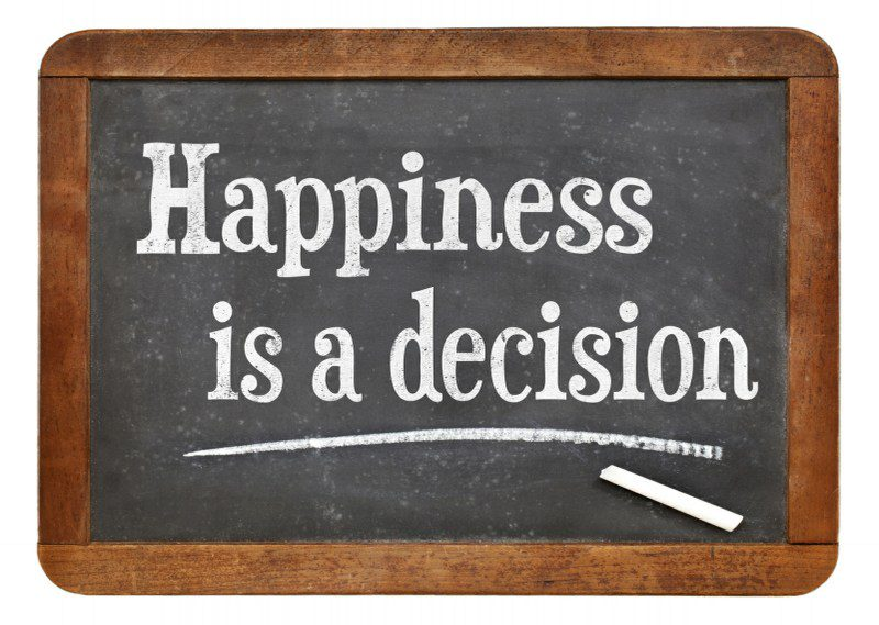 Happiness is a decision written on chalkboard